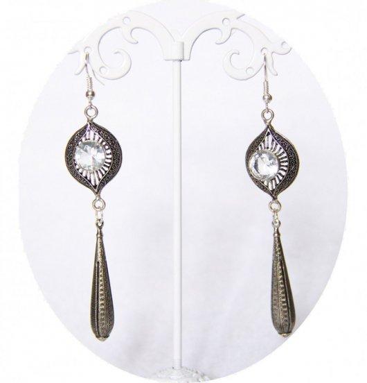 Boucles d'oreilles rétro quartz blanc avec pampille argentée