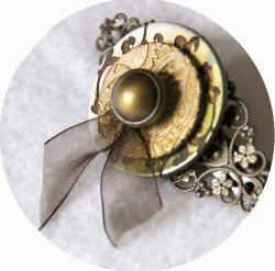 Barrette boutons doré et bronze longueur 8cm
