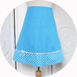 Jupe trapeze courte en coton bleu turquoise a pois blancs et noeud en ruban de satin blanc style pinup